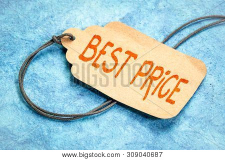 best price sign, marketing concept - handwriting on a paper price tag