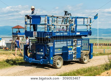 Moacsa, Romania- 30 June 2019: Genie Gs 5390 Self Propelled Scissor Lift Used For Live Tv Broadcasti