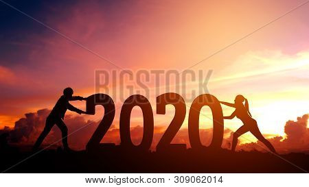 2020 Newyear  Couple Tries To Push Number Of 2020 Happy New Year Concept