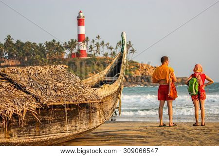 Kerala, India: Dated-june 14, 2019: A Beach In Kerala Goa With A Lighthouse In The Background And A