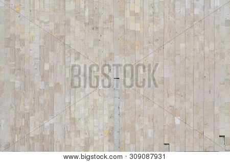 Background Texture Of Old Beige Marble Wall From A Variety Of Large Tiles