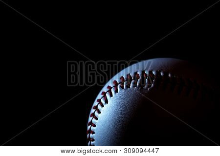 One Of The Baseball With A Dark Background