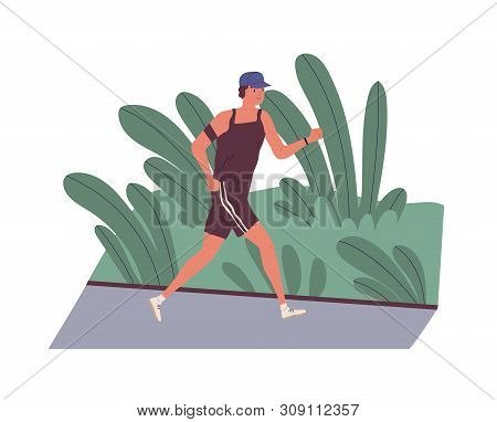 Smiling Young Man Jogging Outdoors In Morning. Cute Funny Male Athlete Running Along Street. Daily F