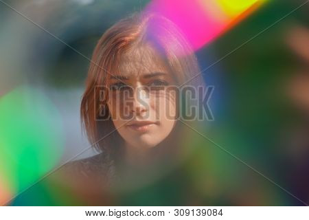 Funky Colorful Portrait Of A Young Woman With Lens Flare And Light Leaks - Authentic Real People Cre