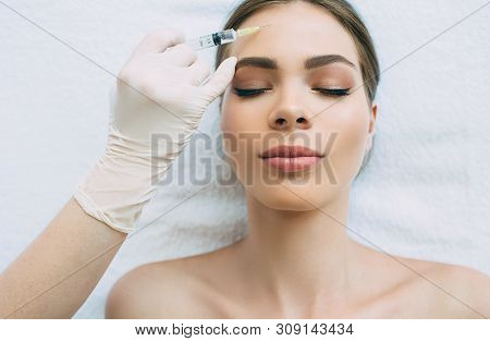 Dysport injections in forehead wrinkles, blocking mimic wrinkles using beauty injections at beauty clinic poster