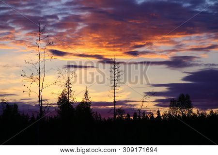Colorful Sunrise In The Middle Of The Night In Sweden.