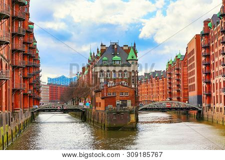 The Warehouse District Speicherstadt During Spring In Hamburg, Germany. Warehouses In Hafencity Quar