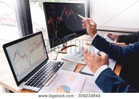 Business Team Investment Entrepreneur Trading Discussing And Analysis Data The Stock Market Charts A