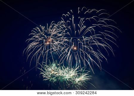 Big And Small, Beautiful Sparkling Volleys Of Festive Salute, Green, In The Night Sky For Any Purpos