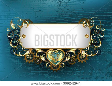 Gold, Antique, Jewelry Steampunk Nameplate With Brass Gears On A Turquoise, Wooden Background. Steam