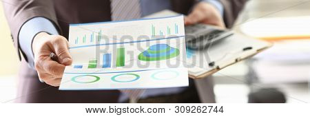 Booker Do Consulting Job Calculation Income Money. Businessman Accounting Revenue With Data On Colou