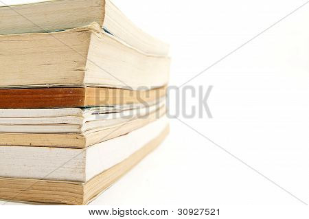 stacks of books on the side with white empty space