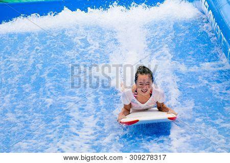 Hua Hin, Thailand - January 2018 : Pretty Girl On Wave Board Water Splash Area In Vana Nava Waterpar