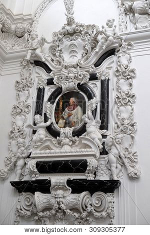 WURZBURG, GERMANY - JULY O4, 2018: Stucco epitaph of Cathedral canon Georg Heinrich von Stadion in Wurzburg Cathedral dedicated to Saint Kilian, Bavaria, Germany