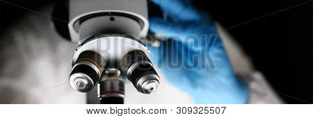 Laboratory Pharmacist Work at Optical Microscope. Scientist Working on Research with Microscopy Metal Lens. Pharmaceutical Lab. Chemist in Coverall Analyzing Experiment with Medical Equipment. poster