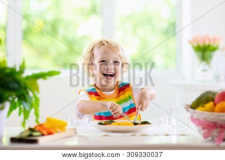 Baby Eating Vegetables. Solid Food For Infant.