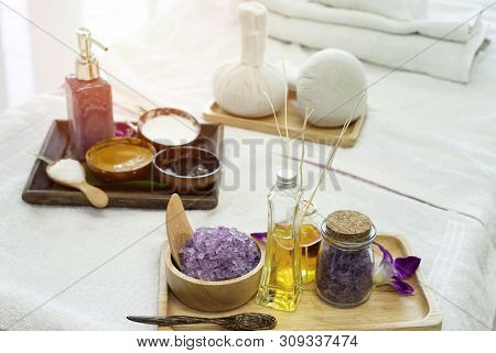Salt And Oil Spa Massage On The Bed.hot Herbal Compresses On The Dish Wood.scrub Cream For Face Spa