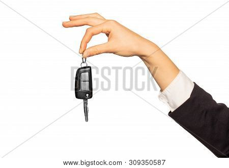 Hand Holding Car Key With Index And Thumb Fingers