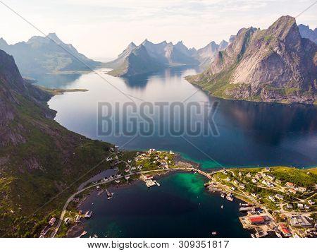 Scenic Fjord Landscape With Reine Village, Coast Nature With Sharp High Mountain Peaks, Lofoten Isla