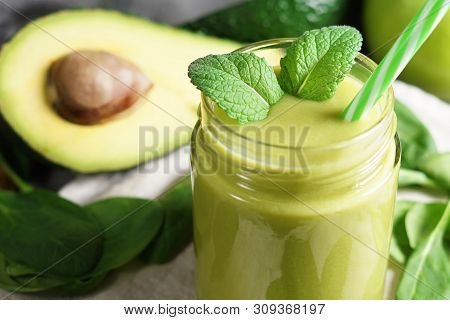 Avocado Spinach And Green Apple Smoothie Healthy And Refreshing Tropical Drink Close-up View Of A Gl