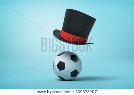 3d Rendering Of Football And Black Tophat Floating In Air Above Ball On Light Blue Background.