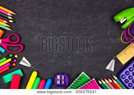 School Supplies Border Frame. Top View On A Chalkboard Background With Copy Space. Back To School Co