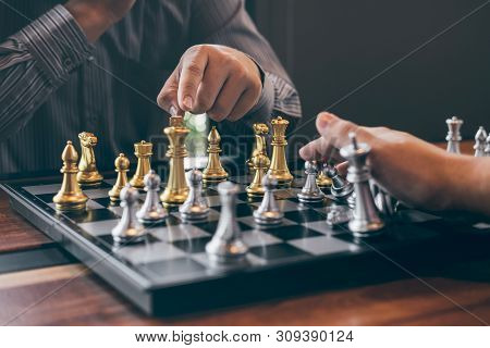 Intelligent Businessman Playing Chess Game Competition With The Opposite Team, Planning Business Str