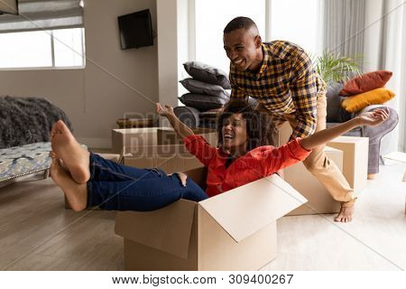 Side view of Happy African american couple having fun together in living room at home