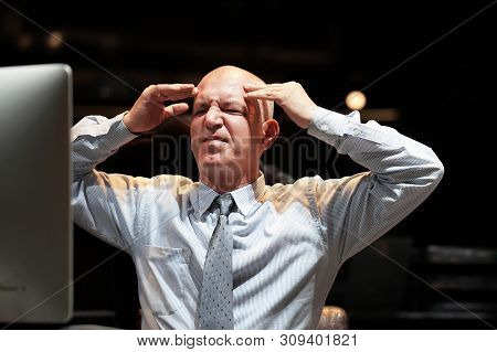 Elderly Office Worker In Front Of A Computer Made A Mistake In The Calculation. Stress, Fright, Faci
