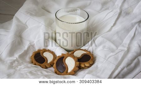 Tasty Fresh Milk On A White Wooden Background. Homemade Cookies And A Glass Of Milk. Copy Space