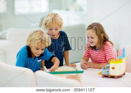 Kids Playing Board Game. Toys For Children.