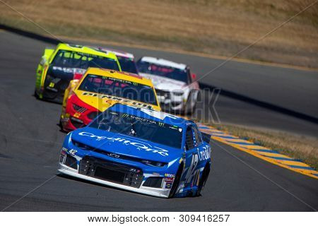 June 23, 2019 - Sonoma, California , USA: Kyle Larson (42) races for position for the TOYOTA/SAVE MART 350 at Sonoma Raceway in Sonoma, California .