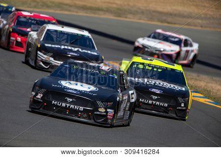 June 23, 2019 - Sonoma, California , USA: Corey LaJoie (32) races for position for the TOYOTA/SAVE MART 350 at Sonoma Raceway in Sonoma, California .