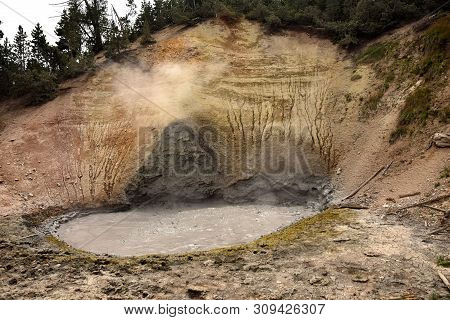 Boiling Volcanic Mud Pond In Yellowstone, Wyoming