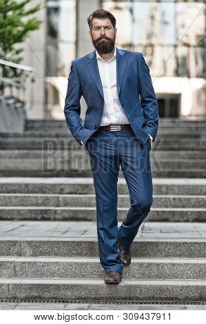 Toward business achievements. Conquer business world. Bearded man going to work. Business man in modern city. Beginning of working day. Motivated for success. Office worker confidently step on stairs. poster