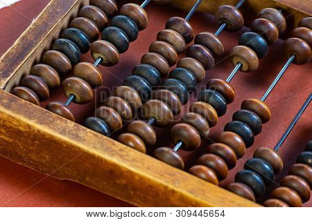 Vintage Wooden Abacus Close Up. Fragment Of Old Abacus Close Up.