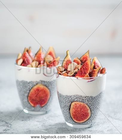 Healthy Chia Pudding With Yogurt, Figs And Nuts In Glass. Ideas And Recipes For Healthy Breakfast, S