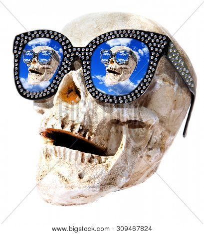 Halloween Skull with Skull Sunglasses. Halloween Scary Skull with repeating Skull Sun Glasses. Fun and Funny Holiday photo. Isolated on white. Room for text. Clipping Path.