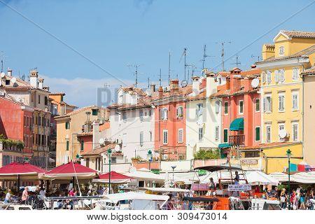 Rovinj, Croatia, Europe - September 2, 2017 - Tourists, Boats And Houses At The Harbour Of Rovinj