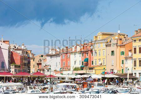 Rovinj, Croatia, Europe - September 2, 2017 - Tourists, Boats And Restaurants At The Harbour Of Rovi