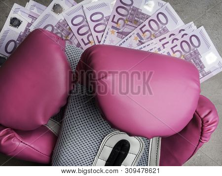 boxing gloves and money. Concept of bribery, dishonesty in sport, greed. poster