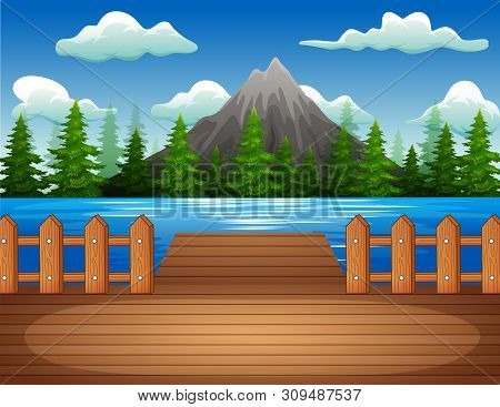 Wooden Pier Overlooking The Lake And Mountain