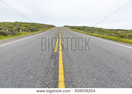 Detail Of Cabrillo Highway With Yellow Median Stripe In California, Usa