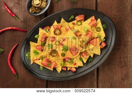 Nachos, Mexican Tortilla Chips, Shot From Above With A Cheese Sauce, Chili And Jalapeno Peppers, Tom