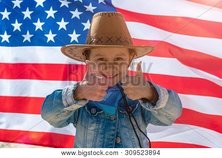 Independence Day. Patriotic Holiday. Happy Kid Thumbs Up, Cute Little Child Girl With American Flag.