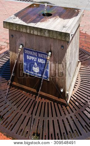 Sandwich, Ma - June 15, 2019: This Public Supply Of Free Spring Water By The Old Grist Mill Is Fed B