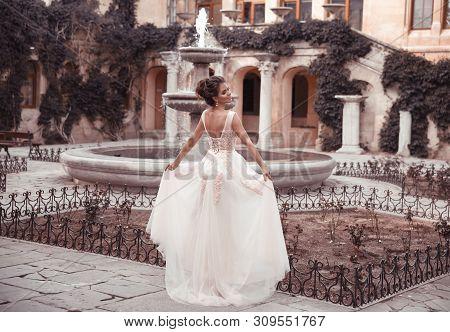 Beautiful Bride In Pink Wedding Dress. Outdoor Romantic Portrait Of Attractive Brunette Woman With H