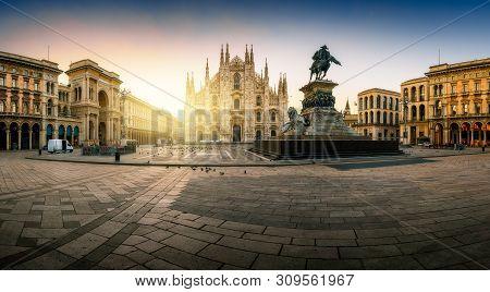 Milan Piazza Del Duomo Square. City Center Illuminated In The Sunrise. Milano, Italy