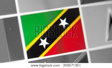 Saint Kitts And Nevis National Flag Of Country. Flag On The Display, A Digital Moire Effect. News Of