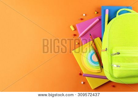 Hipster Neon Green Textile Backpack, Surrounded With School Supplies. Back To School Concept. Lots O